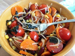 Pasta + veggies (tomato, carrot, corn, seaweed, onion) tossed in olive oil and marmite for added saltiness and B vitamins
